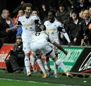 Swansea City's Nathan Dyer (C) celebrates scoring a goal against Cardiff City
