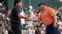 Kevin Stadler, right, winner of the Phoenix Open golf tournament, shakes hands with Bubba Watson