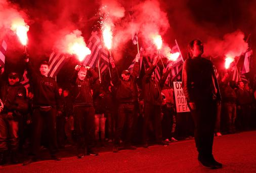 MENACING: Supporters of the far-right Golden Dawn show some force at an Athens rally