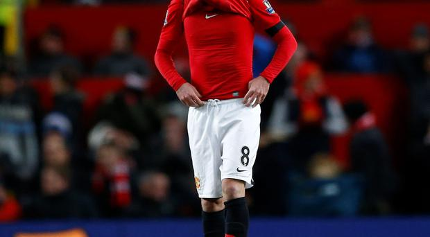 Manchester United's Juan Mata pulls his shirt over his head after their English Premier League soccer match against Fulham at Old Trafford