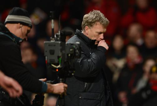 Manchester United Manager David Moyes walks off at the end of the Barclays Premier League match between Manchester United and Fulham at Old Trafford