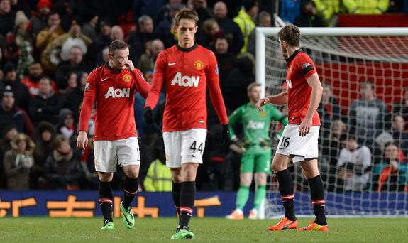 Manchester United's Wayne Rooney shows his dejection after Fulhams second goal with Adnan Januzaj (centre) and Michael Carrick (left)