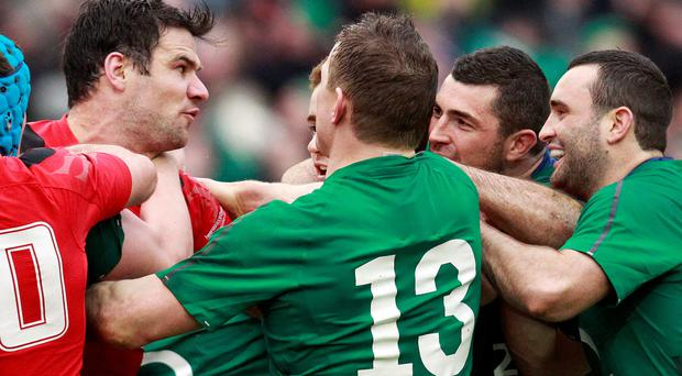 Mike Phillips (left) becomes involved with Rob Kearney at the Aviva Stadium last month