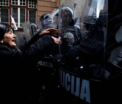 An anti-government protester at police lines in Sarajevo