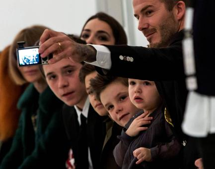 David Beckham takes a selfie at Victoria's show. Reuters