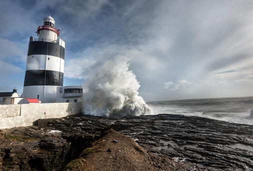 Waves crashing at high tide at Hook Head Lighthouse. Picture Dylan Vaughan.