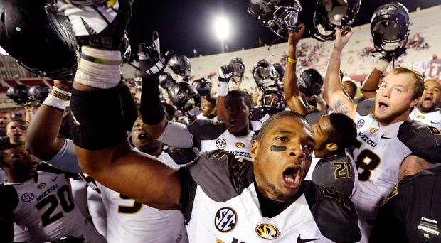 Missouri Tigers defensive lineman Michael Sam (52) reacts after a victory last year