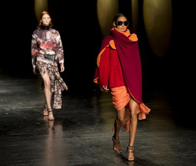 A model wears designs by Prabal Gurung during the Mercedes-Benz Fashion Week Fall/Winter 2014