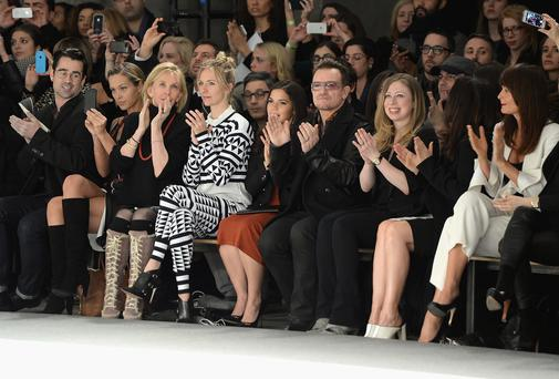 Colin Farrell, Petra Nemcova, Trudie Styler, Mickey Sumner, America Ferrera, Bono, Chelsea Clinton and Helena Christensen attend the Edun fashion show in New York City. (Photo by Theo Wargo/Getty Images)