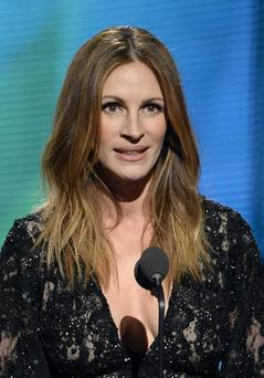 LOS ANGELES, CA - JANUARY 26: Actress Julia Roberts speaks onstage during the 56th GRAMMY Awards at Staples Center on January 26, 2014 in Los Angeles, California. (Photo by Kevork Djansezian/Getty Images)