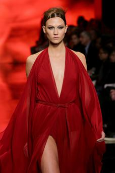 Model Karlie Kloss walks the runway at the Donna Karan New York 30th Anniversary fashion show during Mercedes-Benz Fashion Week Fall 2014 on February 10, 2014 in New York City. (Photo by Neilson Barnard/Getty Images for Mercedes-Benz Fashion Week)