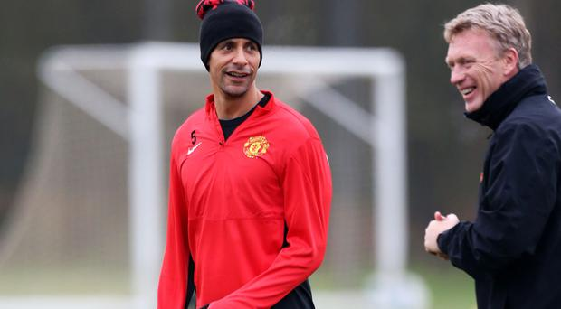 Manchester United manager David Moyes (right) talks to Rio Ferdinand during training