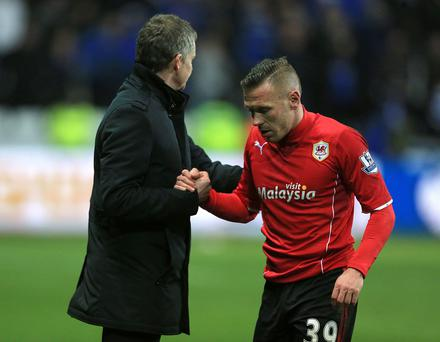 Cardiff City manager Ole Gunnar Solskjaer (left) with Craig Bellamy
