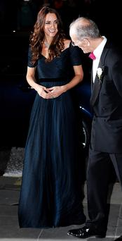The Duchess of Cambridge is greeted by Sandy Nairne, Director of the National Portrait Gallery, as she arrives for The Portrait Gala 2014 at the National Portrait Gallery in central London.