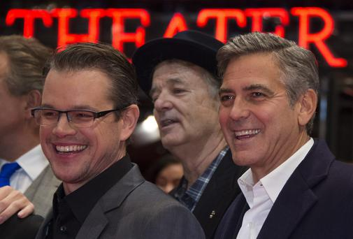 Matt Damon, Bill Murray and George Clooney arrive on the red carpet for a screening of their film The Monuments Men