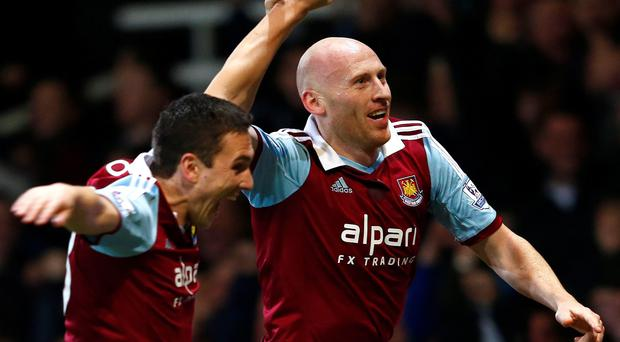 West Ham United's James Collins (R) celebrates with team mate Marco Borriello after scoring a goal against Norwich City