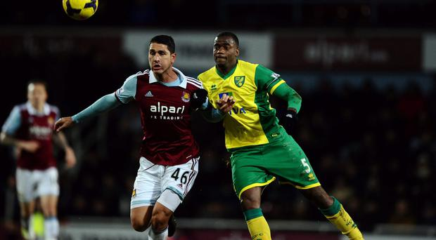 West Ham United's Marco Borriello (left) and Norwich City's Sebastien (right)