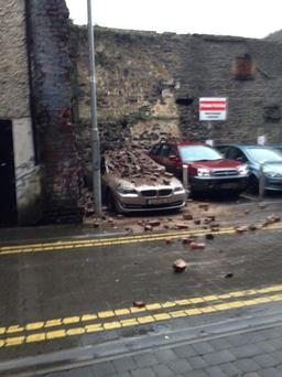 Part of a wall collapses on a parked car in Limerick. (Photo: Twitter/Cillian Flynn)