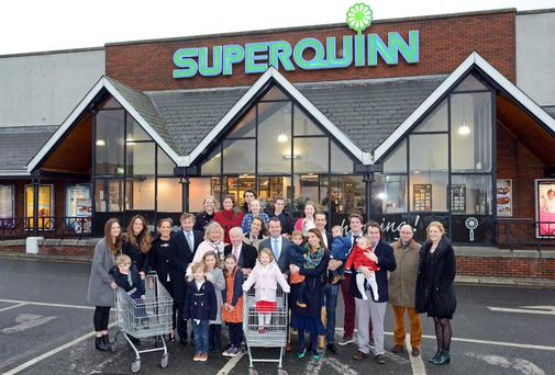Feargal Quinn and members of his family outside the Superquinn store in Sutton, Dublin. Picture: HANNAH LEVY