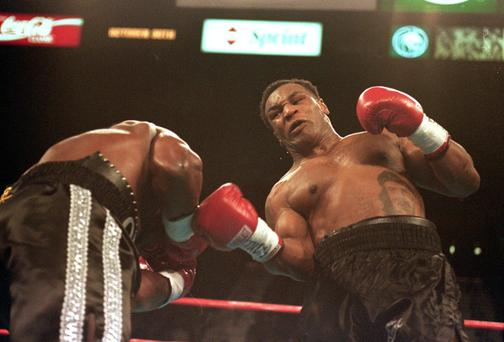 Mike Tyson lands right upper-cut during his fight against Orlin Norris