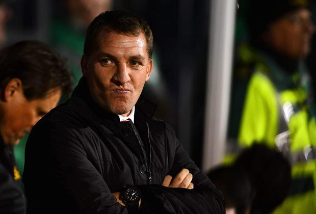 Manager Brendan Rodgers of Liverpool looks on