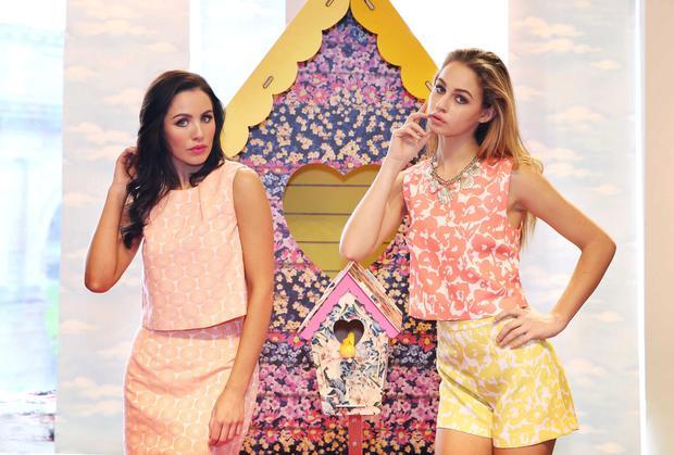 Sinead Noonan (left) at the Oasis SS14 launch wearing Daisy Jacquard Top €47, Daisy Jacquard Skirt €60 & Daisy Jacquard spring coat €106. Thalia Heffernan wears yellow palm beach shorts €40, pink palm beach top €40 and gold shell necklace €17. Photo: Sasko Lazarov/Photocall Ireland