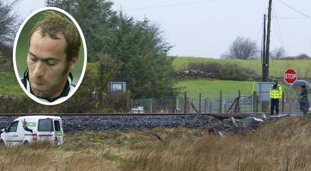 The scene at Ballyvary, Castlebar, where the van driven by John Canning (inset) was hit by a train. Photo : Keith Heneghan / Phocus.