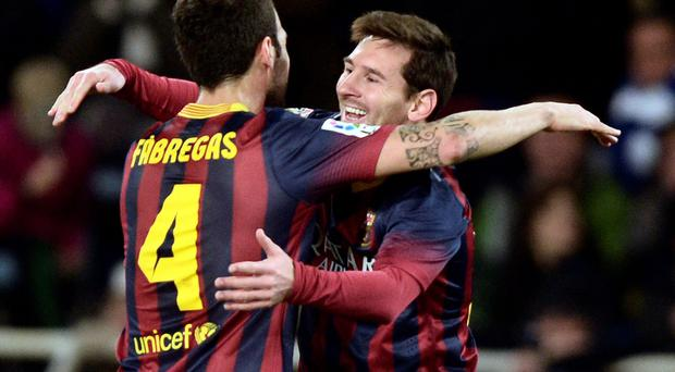 Barcelona's Lionel Messi (R) celebrates his goal with teammate Cesc Fabregas