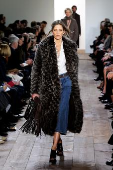 A model walks the runway at the Michael Kors fashion show during Mercedes-Benz Fashion Week Fall 2014 at Spring Studios