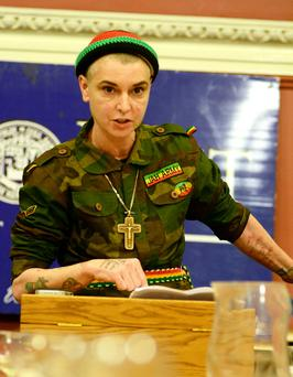 "Dressed in ""Jah Army"" combat fatigues Sinead O'Connor seen at Trinity College to debate whether the Catholic Church Can Be Salvaged with the Historical Society"