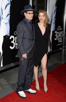 "Actor Johnny Depp and actress Amber Heard arrive at the premiere of ""3 Days to Kill"" at ArcLight Cinemas"