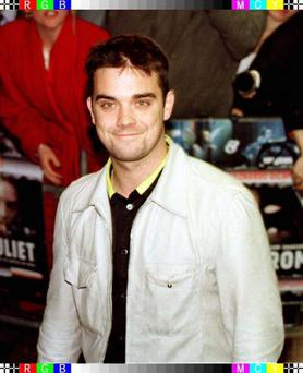 Former Take That star Robbie Williams, who said in an interview in homeless peoples' magazine The Big Issue in 1997 that he had lied about giving up drink and drugs the first time Photo by Samantha Pearce/PA