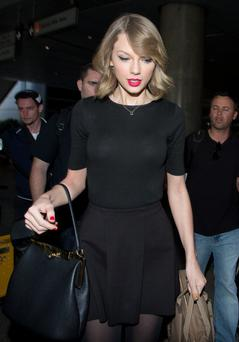 Taylor Swift seen at LAX airport on February 12, 2014 in Los Angeles, California. (Photo by GVK/Bauer-Griffin/GC Images)