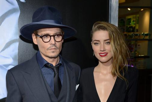 Johnny Depp, left, and Amber Heard arrive at the US premiere of