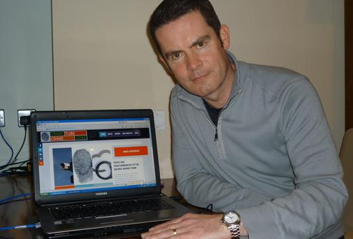 Robert Waters shows off his new website which allows victims of crime to upload CCTV footage of robberies on their homes