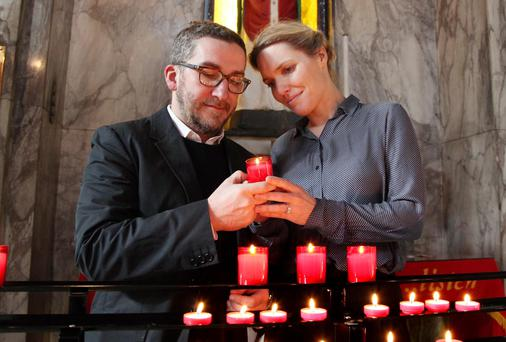 Helen Young and Conor Kavanagh from Dublin at the shrine of St Valentine in Whitefriar Street Church, Dublin. Picture: JOHN MCELROY