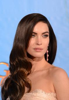 Actress Megan Fox poses in the press room at the Golden Globe awards ceremony in Beverly Hills on January 13, 2013. AFP PHOTO/Robyn BECK (Photo credit should read ROBYN BECK/AFP/Getty Images)
