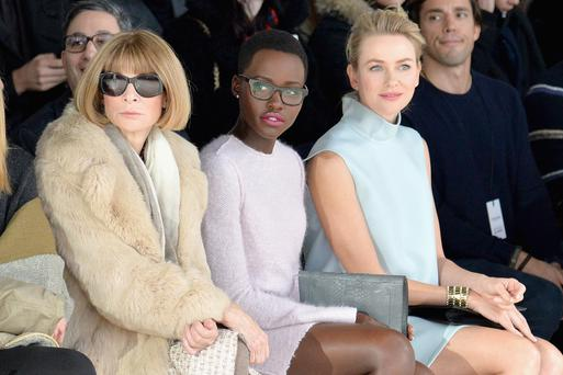 NEW YORK, NY - FEBRUARY 13: Anna Wintour, actresses Lupita Nyong'o and Naomi Watts attend the Calvin Klein Collection fashion show during Mercedes-Benz Fashion Week Fall 2014 at Spring Studios on February 13, 2014 in New York City. (Photo by Larry Busacca/Getty Images for Mercedes-Benz Fashion Week)