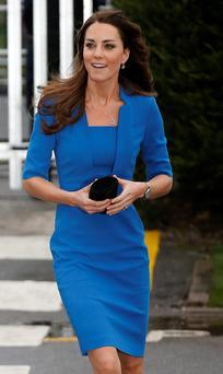 Britain's Catherine, the Duchess of Cambridge, arrives at Northolt High School in Ealing in west London February 14, 2014. She was due to officially open the ICAP Art Room, in her role as a Royal Patron of the young person's art-based charity The Art Room. REUTERS/Olivia Harris (BRITAIN - Tags: ROYALS PROFILE)