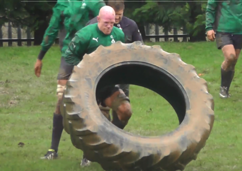 Ireland captain Paul O'Connell battling with a very large tyre