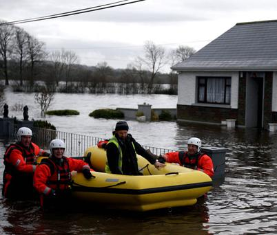 Loughrea Fire Crew evacuating Cathal Willers from his flooded home in Castledaly, Ardrahan, Co. Galway