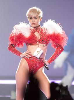 VANCOUVER, BC - FEBRUARY 14: American singer Miley Cyrus opens her