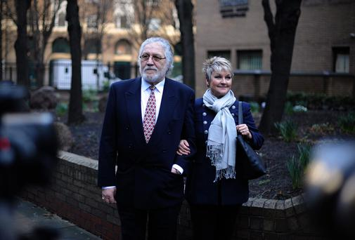 Innocent: Dave Lee Travis, who had to seel his house to fund his defence, leaves court in London, accompanied by his wife Marianne