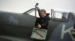 Prince Harry sits in a Spitfire during a visit to the Boultbee Flight Academy in Goodwood, West Sussex. Photo: Paul Grover.