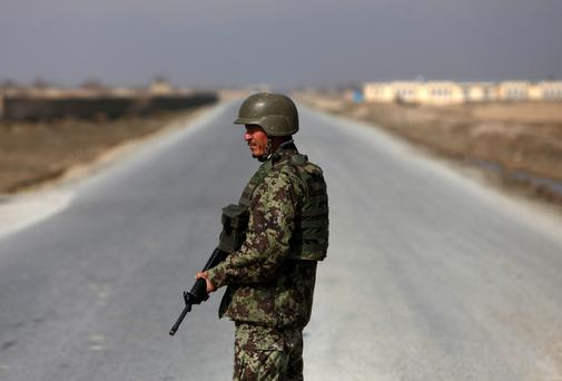An Afghan National Army (ANA) soldier stands guard near the Bagram detainee centre gate north of Kabul February 13, 2014. Photo: Reuters.