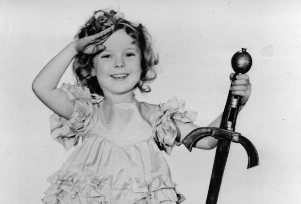 Shirley Temple photographed in 1936. The child star put smiles on the faces of moviegoers all over America