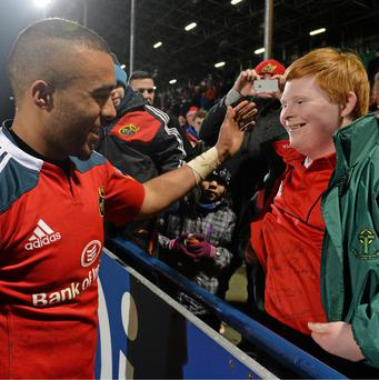 Simon Zebo, Munster, is congratulated after the game by fifteen-year-old Dylan Kennedy, from Grange, Cork. Photo: Diarmuid Greene / SPORTSFILE