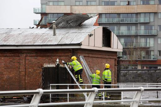 The Limerick City Fire and Rescue team try and make safe Limerick Boat club after its roof was torn off during storm Darwin. Picture: Sean Curtin Photo