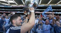Dublin's Bernard Brogan, holds the Sam Maguire Cup to Dublin fans after victory over Mayo in the All Ireland Football Final at Croke Park. Picture : Damien Eagers / Irish Independent