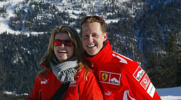 German Formula 1 driver Michael Schumacher posing with his wife Corinna, in the winter resort of Madonna di Campiglio